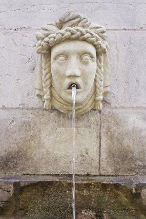 Ancient Roman fountain shaped face, the architectu...