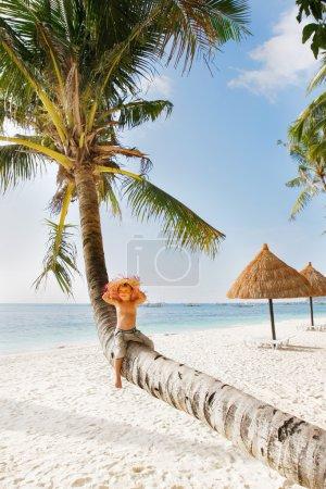 happy boy on tropical beach
