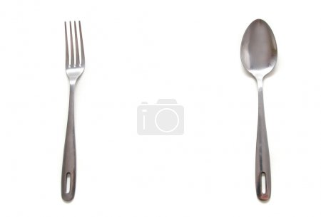 spoon and fork over white