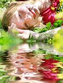 portrait of beautiful girl laying green grass