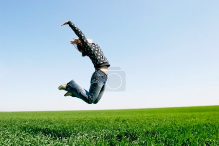 Photo for Happy girl jumping on natural background - Royalty Free Image