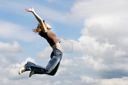 jumping girl on sky background