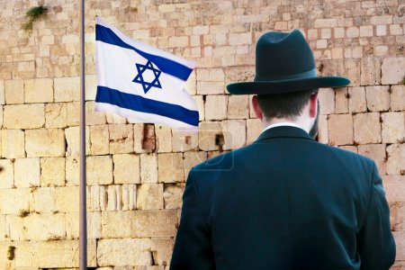 rare view of jew on the wailing western wall background, jerusal