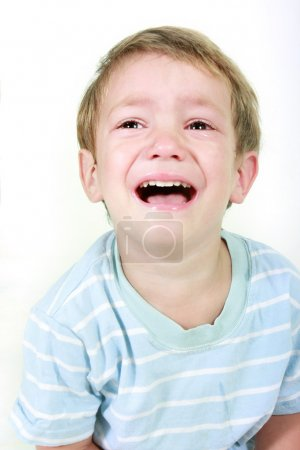 Photo for Crying boy over white - Royalty Free Image