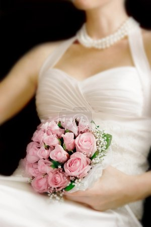 wedding bouquet in bride's hands, focus on flowers