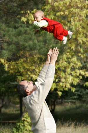 Photo for Young father playing with his son - Royalty Free Image