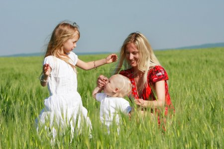 happy mother with two children on nature