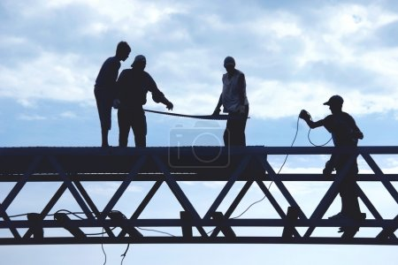 silhouette workers on construction site