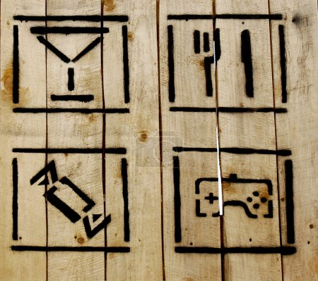 several simple icons on wooden background