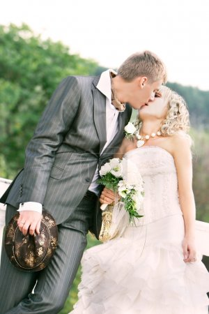 kissing couple on their wedding day