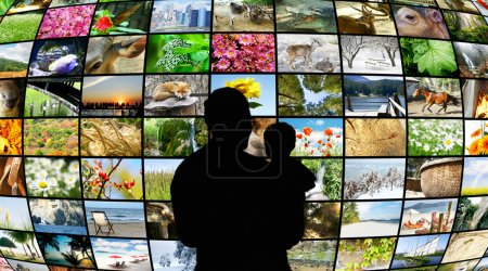 Father and son looking at tv screens showing beauty in nature