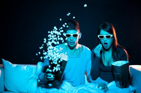 Photo for Love couple in 3D glasses at home - Royalty Free Image