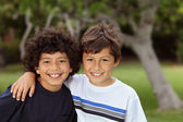 Two smiling happy young mixed race boys