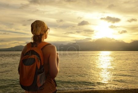 Girl with a backpack dreams of travel