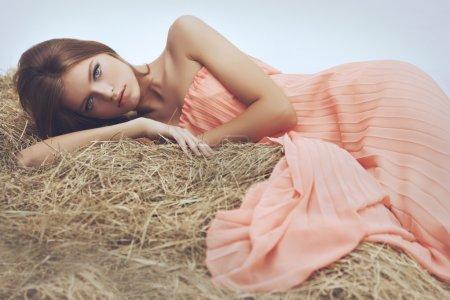 Girl lying on hay