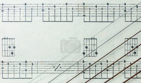 Guitar Strings on Old Yellowed Music Sheet no Lyrics, Closeup