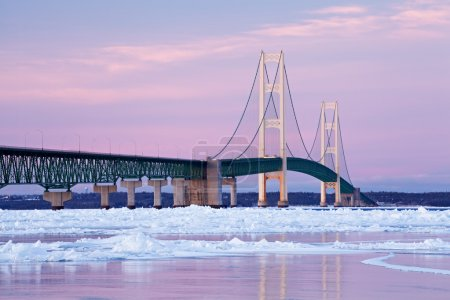 Photo for Winter landscape near sunset of the Mackinac Bridge and the frozen Straits of Mackinac, Michigan's Upper and Lower Peninsulas, USA - Royalty Free Image