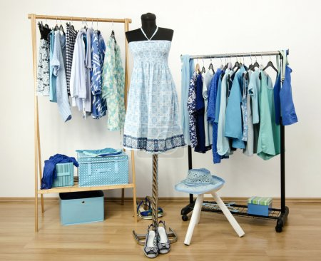 Photo for Wardrobe full of all shades of blue clothes, shoes and accessories. - Royalty Free Image