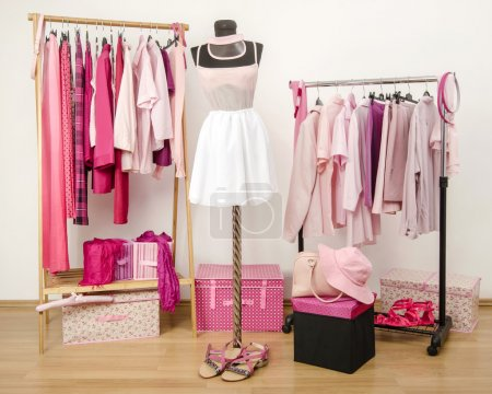Photo for Wardrobe full of all shades of pink clothes, shoes and accessories. - Royalty Free Image