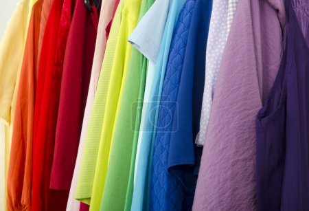 Photo for Detail on all colors clothes hanging on a rack nicely arranged. - Royalty Free Image