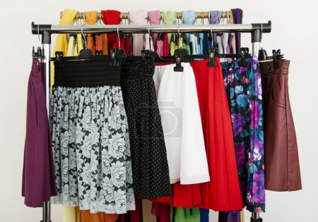 Cute summer skirts displayed on a rack.