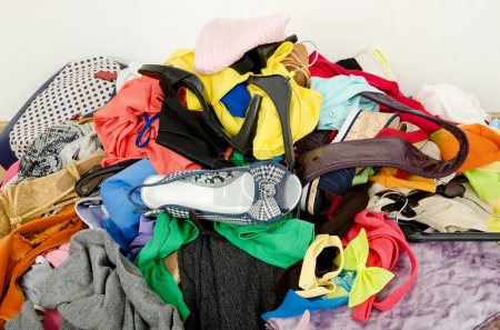 Photo for Untidy cluttered wardrobe with colorful clothes and accessories. - Royalty Free Image