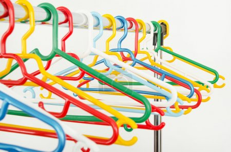 Rack of clothes with empty hangers.
