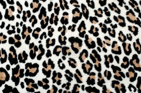 Brown and black leopard pattern. Fur animal print as background.