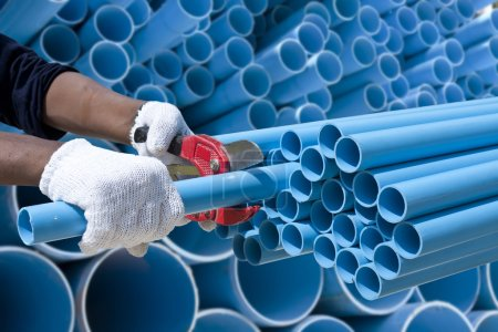 Worker cut pvc pipe