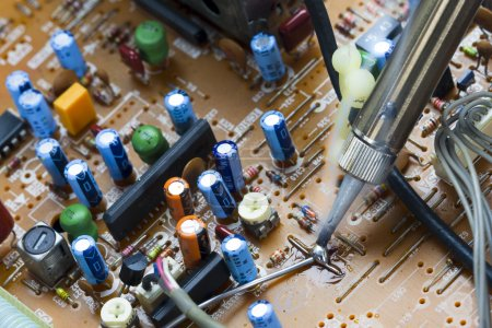 Photo for Soldering iron and verification testing of electronic boards - Royalty Free Image