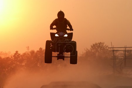 Quad bike Jump in the sunset