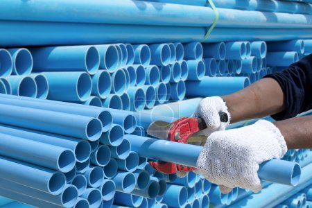 Worker cut pvc pipe in construction site