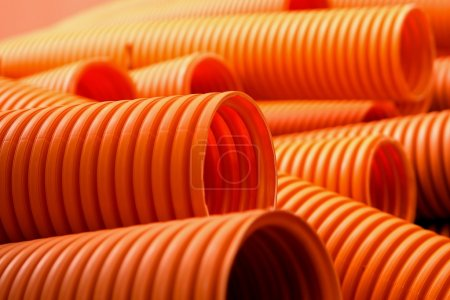 Orange plastic pipes on the construction