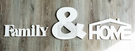 Photo for Family and home sign made from wood and ready for present - Royalty Free Image