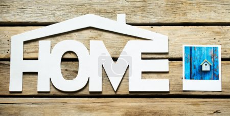 Home sign next to the photo