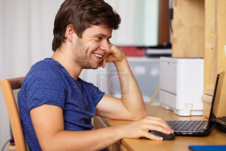 Young handsome guy with laptop, background