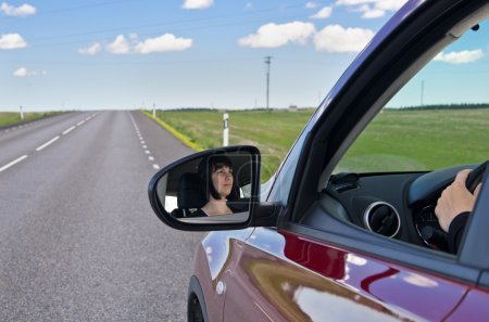 Photo for Young woman driving car on highway - Royalty Free Image