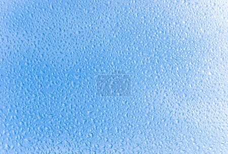 Photo for Blue sky through the glass with water drops - Royalty Free Image