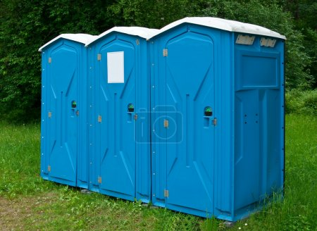 Photo for Public transportable toilets placed in park - Royalty Free Image