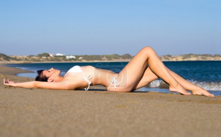 Young woman lying on beach