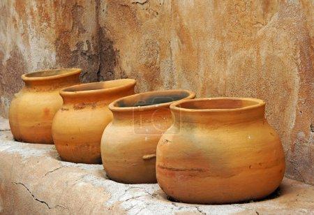 Clay pots on the shelf