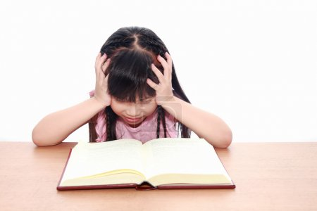 serious little girl reading a book