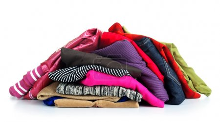 Big heap of colorful clothes, view from above, isolated on white background.