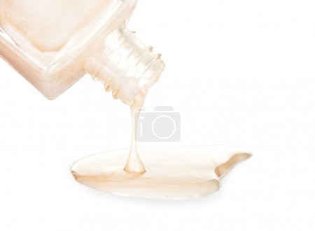 Bottle of the white nail polish isolated