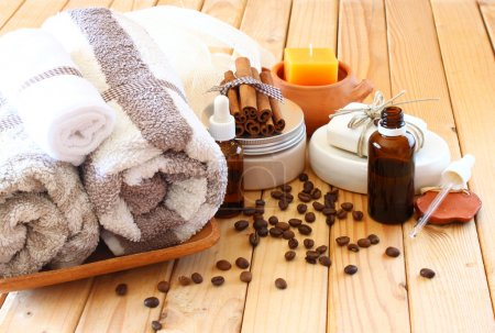Spa and wellness setting with natural bath salt, candles and towel