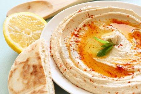 Hummus dip plate and lemon