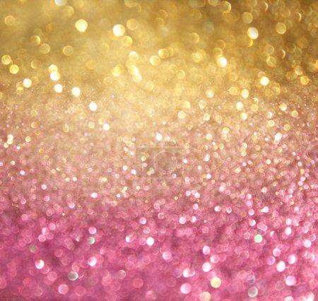 Foto de Luces de oro y rosa abstracta bokeh. Fondo Defocused - Imagen libre de derechos