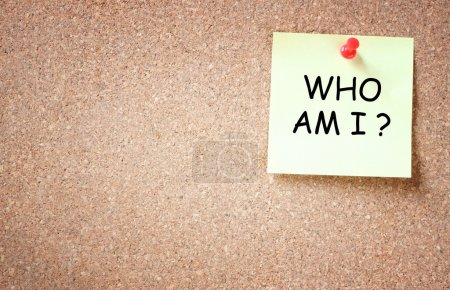 Sticky pinned to corkboard with the phrase who am i? . room for text.