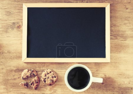 Empty blackboard with cup