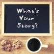 Blackboard with the phrase whats your story and cu...